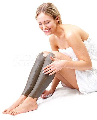 Buy stock photo Beautiful girl using mud treatment