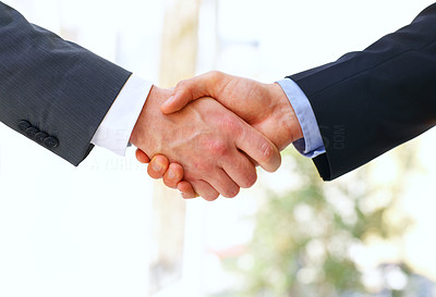 Buy stock photo Cropped closeup shot of two businessmen shaking hands