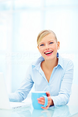 Young business person using laptop holding cup of coffee over white background