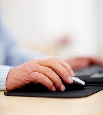 Closeup of old man hands using computer mouse
