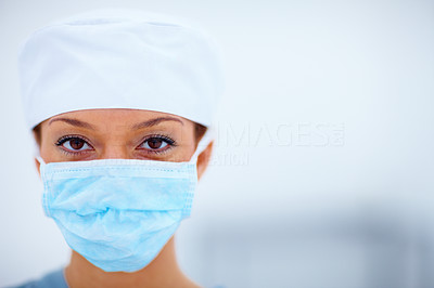 Closeup of female doctor wearing surgical cap and mask