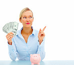 Finance - Woman holding dollar bills pointing at copyspace