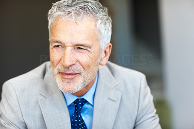 Buy stock photo Shot of a mature businessman looking thoughtful