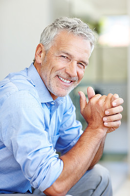 Buy stock photo Shot of a mature businessman standing indoors
