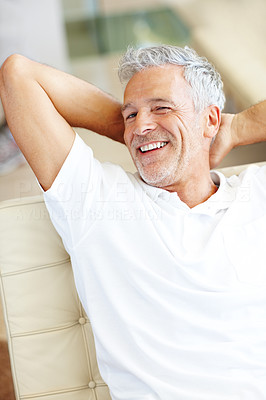 Buy stock photo Smiling senior man relaxing on sofa
