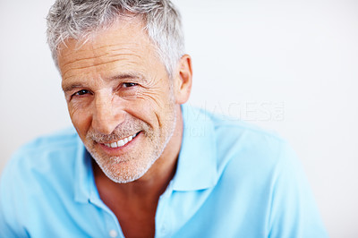 Buy stock photo Portrait of a handsome mature man smiling on white