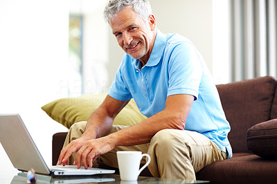 Buy stock photo Casual mature business man using a laptop
