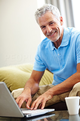 Buy stock photo Happy mature man using a laptop at home