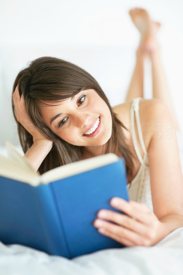 Buy stock photo An attractive young female reading a book