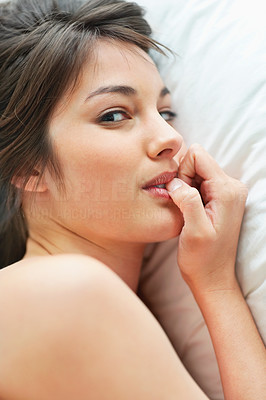 Buy stock photo Beautiful young female lying in bed