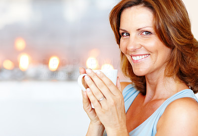 Buy stock photo Beautiful young woman holding cup of coffee
