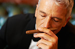 Rich man smelling cigar