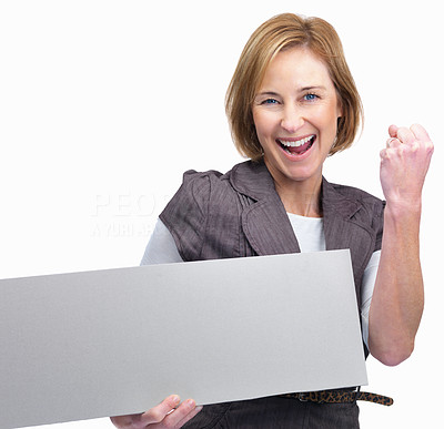 Buy stock photo Excited middle aged woman holding a blank board