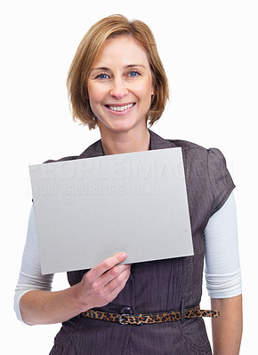 Buy stock photo An attractive lady holding a blank billboard isola