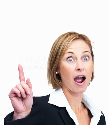 Buy stock photo Surprised woman pointing upwards at copyspace