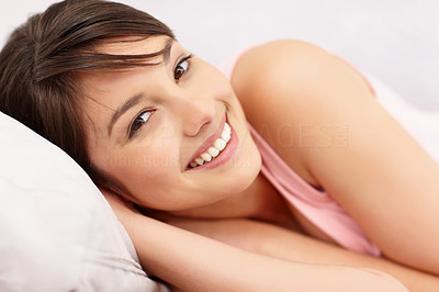 Buy stock photo Happy cute young female smiling in bed