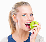 Isolated portrait of young woman eating apple