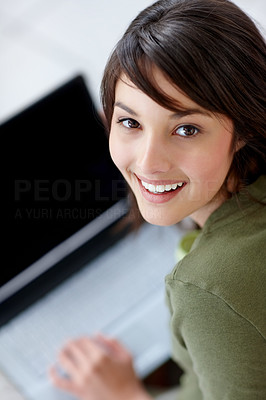 Buy stock photo Cute young female using a laptop