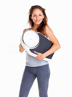 Buy stock photo Happy woman carrying a scale against white background