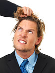 Angry businessman being pulled by the hair, conceptual shoot