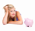 Portrait of a beautiful young girl with piggy bank