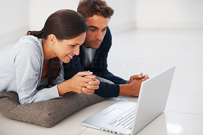 Buy stock photo Handsome man and woman looking at laptop