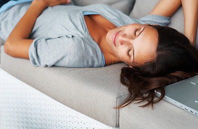 Buy stock photo Pretty woman lying on sofa with eyes closed and slight smile