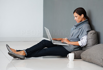 Buy stock photo Pretty woman with cup of coffee and laptop