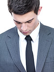 Young business man looking down, isolated portrait