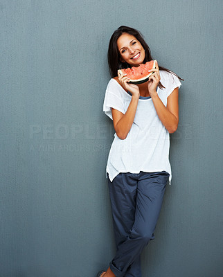 Buy stock photo Woman leaning against blue background holding watermelon