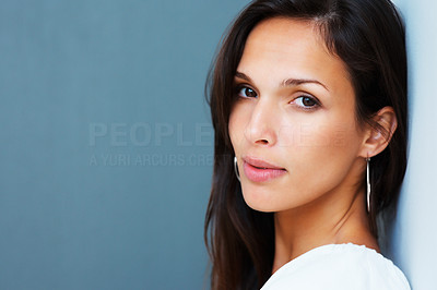 Buy stock photo Sexy woman looking into camera against blue background