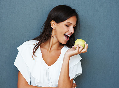 Buy stock photo Woman about to take a bite of an apple