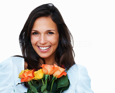 Buy stock photo Beautiful woman smiling happily while holding a bunch of fresh roses against a white background with copyspace