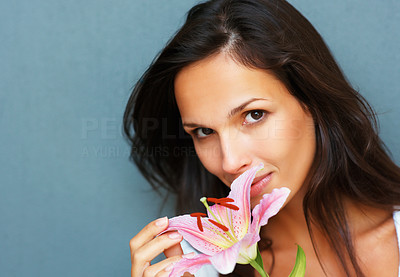 Buy stock photo Head shot of pretty woman touching petals of a flower