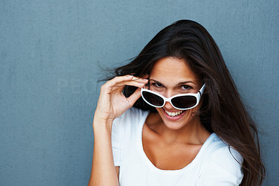 Buy stock photo Pretty woman wearing sunglasses on tip of nose and smiling