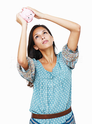 Buy stock photo Brunette holding piggy bank above head against white background