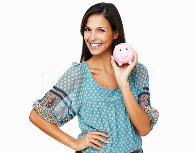 Buy stock photo Brunette holding piggy bank in hand while smiling