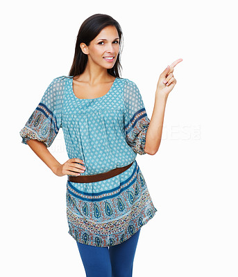 Buy stock photo Brunette pointing with hand on hip against a white background