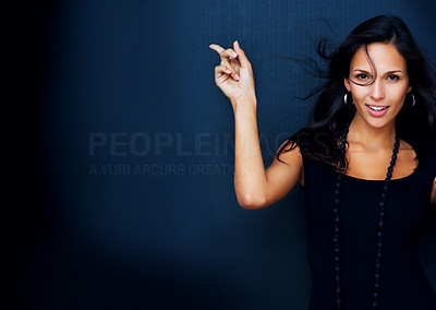 Buy stock photo Woman looking into camera and pointing away