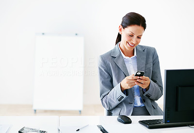 Executive text messaging on cell phone