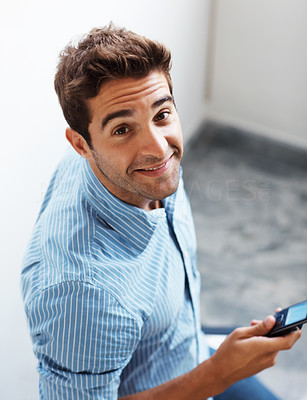 Buy stock photo Portrait of a smart young guy text messaging on mobile phone