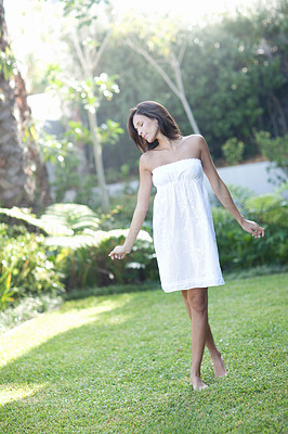 Buy stock photo Blurred image of a pretty young woman standing in park - Outdoor