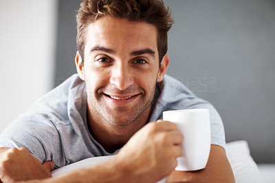 Buy stock photo Closeup portrait of a happy young man having a cup of coffee