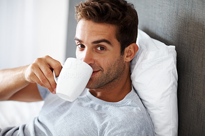 Buy stock photo Portrait of handsome young man drinking a hot cup of coffee - Indoor