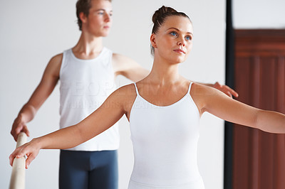 Buy stock photo Portrait of a young female dancer with trainer in background
