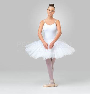 Buy stock photo Full length of a young ballerina wearing tutu posing against white background - copyspace