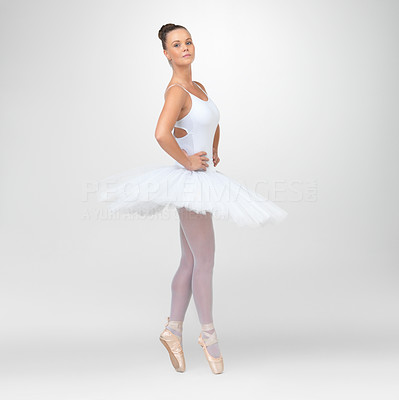 Buy stock photo Full length of a beautiful ballerina dancing against white background - copyspace