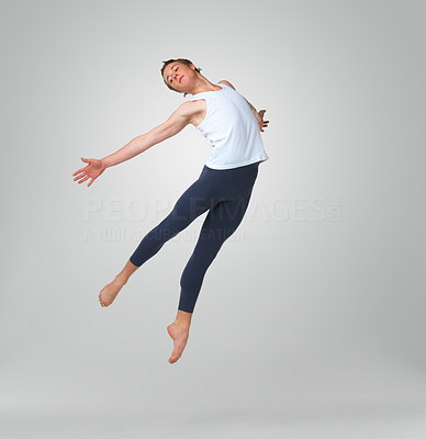 Buy stock photo Full length of a male ballet dancer leaping against white background - copyspace