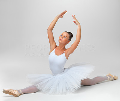 Buy stock photo Full length of a beautiful ballerina performing against white background - copyspace