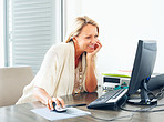 Mature business or casual woman working on computer at desk